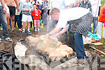 Duagh Summer Festival : Chef John Relihan unveiling the pig that was cooked underground in the Hangi style of cooking during the BBQ on Sunday last at the back of O'Brien's Bar.