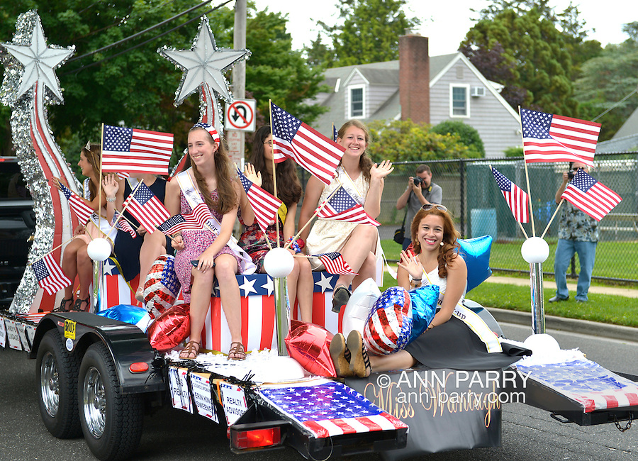 Wantagh, New York, USA. 4th July 2015. Past participants in The Miss Wantagh Pageant ceremony, a long-time Independence Day tradition on Long Island, ride on a float in the town's July 4th Parade. After the parade, the Miss Wantagh Pageant 2015 ceremony was held. Since 1956, the Miss Wantagh Pageant, which is not a beauty pageant, crowns a high school student based mainly on academic excellence and community service.