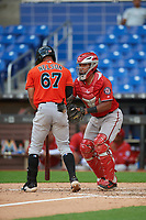 Washington Nationals catcher Adalberto Carrillo tags James Nelson (67) during a Florida Instructional League game against the Miami Marlins on September 26, 2018 at the Marlins Park in Miami, Florida.  (Mike Janes/Four Seam Images)