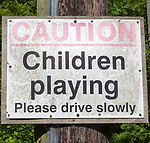 Caution children playing road sign, England, UK
