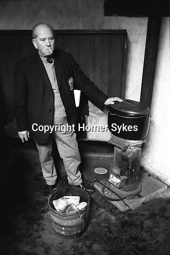 Wassailing the Apple Tree. Carhampton Somerset. England . 1972. Toast in the Wassailing bucket is soaked in mulled cider, made from a secret receipt and placed in the apple tree, to ensure a good crop for the following year.<br />