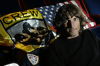 21 February 2006: Columbus Crew and U. S. World Cup soccer player Frankie Hejduk poses with a Columbus Crew and American flag during an interview at the Southern Theatre in Columbus, Ohio.<br />