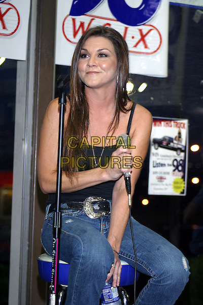GRETCHEN WILSON.Helps radio station WSIX-The Big 98-give away a brand new Chevy Truck to one lucky winner. The runner-up will get this autographed guitar..September 20th, 2005.Credit: Randi Radcliff/Admedia/Capital Pictures.Ref: RR.half length jeans denim black top sitting microphone.www.capitalpictures.com.sales@capitalpictures.com.© Capital Pictures.