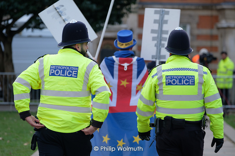 Metropolitan Police officers escort anti-Brexit campaigner Steve Bray out of the media encampment on College Green outside the Houses of Parliament as MPs start five days of debate on the withdrawal agreement with the EU, Westminster, London.
