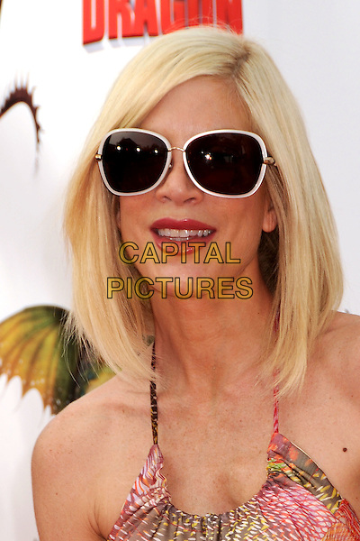 "TORI SPELLING .""How To Train Your Dragon"" Los Angeles Premiere held at the Gibson Amphitheatre, Universal City, California, USA, 21st March 2010..arrivals portrait headshot sunglasses halterneck white frames frames rimmed .CAP/ADM/BP.©Byron Purvis/AdMedia/Capital Pictures."