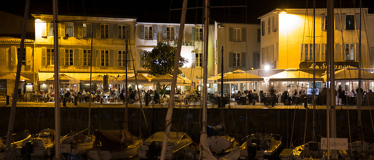 Harbour view, yachts moored and evening al fresco dining at St Martin de Re on Ile de Re, France