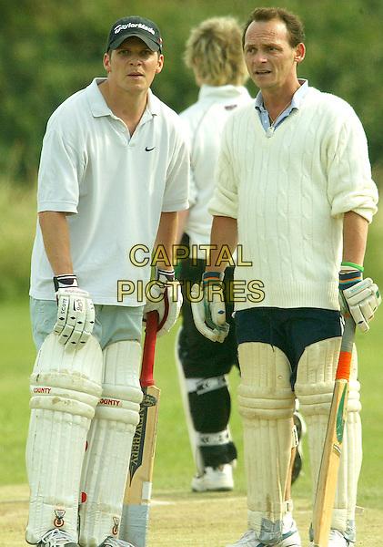 NIGEL HARMAN & PERRY FENWICK.Eastenders cast play Celebrity Cricket Match,.Ali Pali, June 26th 2005..full length sport cap hat whites.Ref: FEE.www.capitalpictures.com.sales@capitalpictures.com.©Capital Pictures.
