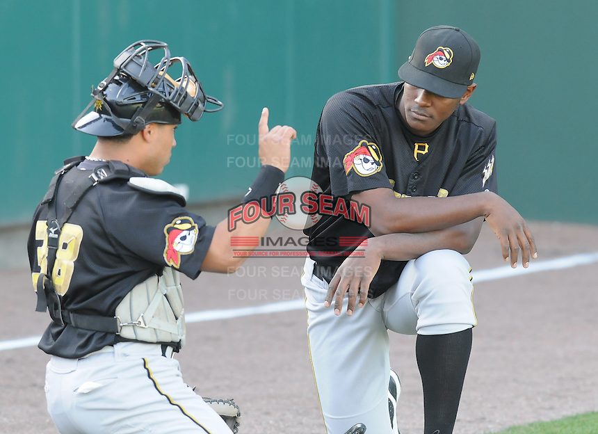 Catcher Ramon Cabrera talks with pitcher Melkin Laureano of the West Virginia Power, Class A affiliate of the Pittsburgh Pirates, at a game against the Greenville Drive April 29, 2010, at Fluor Field at the West End in Greenville, S.C. Photo by: Tom Priddy/Four Seam Images