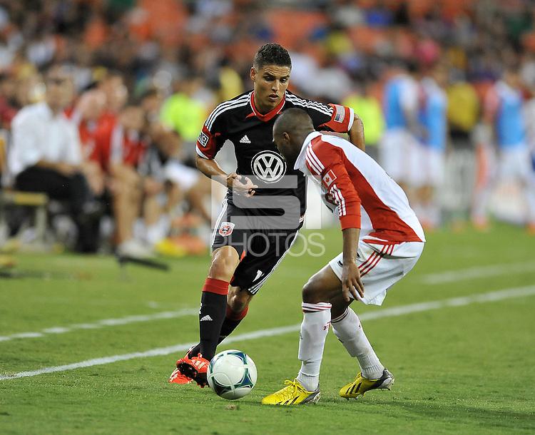Luis Silva (12) of D.C. United goes against Ashtone Morgan (5) of Toronto FC. Toronto FC tied D.C. United 1-1, at RFK Stadium, Saturday August 24 , 2013.