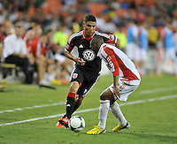 Luis Silva (12) of D.C. United goes against Ashtone Morgan (5) of Toronto FC. Toronto FC tied D.C. United 1-1, at RFK Stadium, Saturday August 24 , 2013.