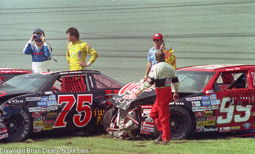 Drivers Kyle Petty, Michael Waltrip, and Tommy Ellis survey the damage after one of the biggest crashes in the history of Daytona Internationa Speedway , a 24 car accident during the Goody's 300, NASCAR Busch Series, Daytona Beach, FL, February 17, 1990.  (Photo by Brian Cleary/www.bcpix.com)s