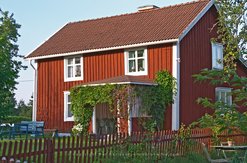 The red houses on the road in Bullerbyn Norrgården, The North House. The original location where Astrid Lindgren's story on Bullerbyn was filmed. In reality called Sevedstorp. Smaland region. Sweden, Europe.