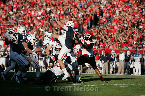 Trent Nelson  |  The Salt Lake Tribune.Utah's Greg Bird (35) and Dave Fagergren (51) block a punt by Arizona's Kyle Dugandzic during the first half as Utah faces Arizona, college football at Arizona Stadium in Tucson, Arizona, Saturday, November 5, 2011.