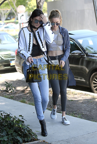 WEST HOLLYWODD, CA - JUNE 2: Kendall Jenner and Gigi Hadid seen out and about after a stop at Zinc Cafe in West Hollywood, California on June 2, 2016.  <br /> CAP/MPI/JM<br /> &copy;JM/MPI/Capital Pictures
