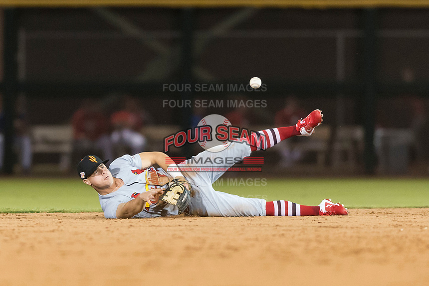 Surprise Saguaros second baseman Andy Young (29), of the St. Louis Cardinals organization, flips the ball to Cole Tucker (not pictured) after making a diving play during an Arizona Fall League game against the Scottsdale Scorpions at Scottsdale Stadium on October 15, 2018 in Scottsdale, Arizona. Surprise defeated Scottsdale 2-0. (Zachary Lucy/Four Seam Images)