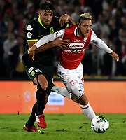 BOGOTA-COLOMBIA, 08-03-2020: Diego Valdes de Independiente Santa Fe y Diego Braghieri de Atletico Nacional disputan el balon durante partido entre Independiente Santa Fe y Atletico Nacional de la fecha 8 por la Liga BetPlay DIMAYOR 2020 jugado en el estadio Nemesio Camacho El Campín de la ciudad de Bogota. / Diego Valdes of Independiente Santa Fe and Diego Braghieri of Atletico Nacional vie for the ball during a match of the 8th date between Independiente Santa Fe and Atletico Nacional, for the BetPlay DIMAYOR I Leguaje 2020 at the Nemesio Camacho El Campin Stadium in Bogota city. / Photo: VizzorImage / Luis Ramirez / Staff.