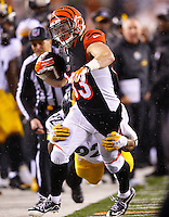 Rex Burkhead #33 of the Cincinnati Bengals is tackled by James Harrison #92 of the Pittsburgh Steelers during the Wild Card playoff game at Paul Brown Stadium on January 9, 2016 in Cincinnati, Ohio. (Photo by Jared Wickerham/DKPittsburghSports)