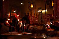 Lighting incense, Man Mo Temple, Hong Kong.