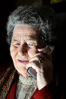 Salvadora Arranz, 87 years old, receives a call of one of her two sons since a Spanish prison to more than 800 kilometres of distance from the Basque Country in the Basque city of Irun on february 19, 2009. Antxon and Txomin Troitiño are imprisoned in two Spanish prisons to more than 800 km from their home. Salvadora receives a weekly call timed 4 minutes and 58 seconds of each son. (Ander Gillenea / Bostok Photo)