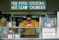 Salesman sells FISH to tourists at FISHERMAN'S WHARF - SAN FRANCISCO, CALIFORNIA.
