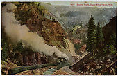 &quot;Double Track - Eagle River Canyon.&quot;  Tracks on sides of stream.  Train passing by.<br /> Eagle River Canyon, CO