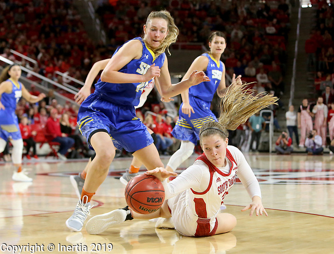 VERMILLION, SD - JANUARY 6: Tagyn Larson #24 from South Dakota State University battles for the loose ball with Chloe Lamb #22 from the University of South Dakota during their game Sunday afternoon at the Sanford Coyote Center in Vermillion, SD. (Photo by Dave Eggen/Inertia)