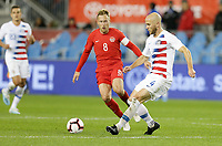 TORONTO, ON - OCTOBER 15: Michael Bradley #4 of the United States passes off the ball during a game between Canada and USMNT at BMO Field on October 15, 2019 in Toronto, Canada.