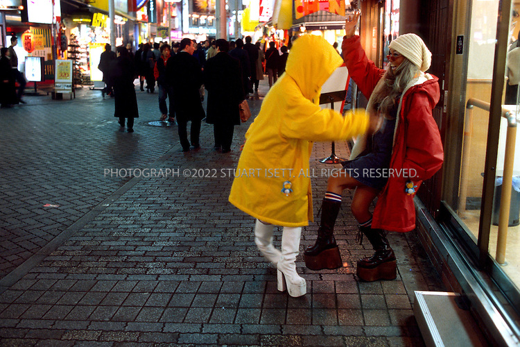 3/5/2000-Tokyo, Japan..Ami Yamazaki and Misa Horii  (left and right) get ready for a night out in Shibuya...All photographs ©2003 Stuart Isett.All rights reserved.This image may not be reproduced without expressed written permission from Stuart Isett.