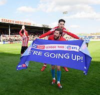 Lincoln City's Josh Vickers gives team-mate Tom Pett a piggy back as they celebrate securing promotion from Sky Bet League Two<br /> <br /> Photographer Chris Vaughan/CameraSport<br /> <br /> The EFL Sky Bet League Two - Lincoln City v Cheltenham Town - Saturday 13th April 2019 - Sincil Bank - Lincoln<br /> <br /> World Copyright &copy; 2019 CameraSport. All rights reserved. 43 Linden Ave. Countesthorpe. Leicester. England. LE8 5PG - Tel: +44 (0) 116 277 4147 - admin@camerasport.com - www.camerasport.com