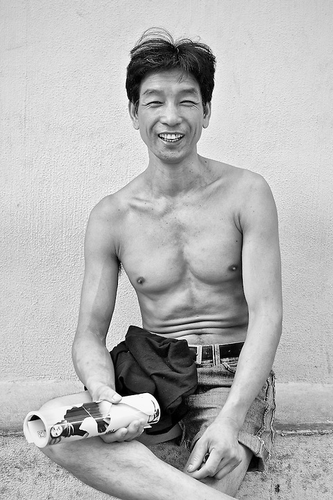 A Cheerful Chap Enjoying The Late Afternoon Sun In Sham Shui Po, Hong Kong.