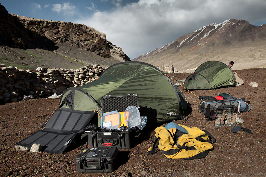 Tent and equipment of photographer Matthieu Paley. Trekking up and along the Wakhan river, the only way to reach the high altitude Little Pamir plateau, home of the Afghan Kyrgyz community.