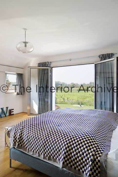 The master bedroom is light and airy and has a balcony to make the most of the view.