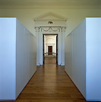 A view into the rotunda from the master bedroom between two monolithic wardrobe units