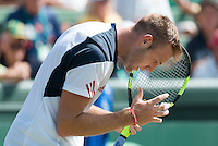 March 4, 2016: Jack Sock of USA reacts after losing a point against Bernard Tomic of Australia during match two of the BNP Paribas Davis Cup World Group first round tie between Australia and USA at Kooyong tennis club in Melbourne, Australia. Photo Sydney Low