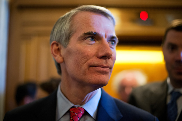 UNITED STATES - JUNE 26:  Sen. Rob Portman, R-Ohio, speaks with reporters before the senate luncheons in the Capitol.  (Photo By Tom Williams/CQ Roll Call)