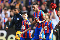 Wilfred Zaha of Crystal Palace leads out his two mascots during Crystal Palace vs Brighton & Hove Albion, Premier League Football at Selhurst Park on 14th April 2018