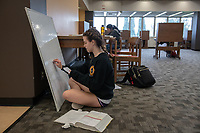Hope Hendry '21, writes on board, studies for organic chemistry<br /> Occidental College students study for finals and write papers during finals week in the Academic Commons/Mary Norton Clapp Library, Monday, May 6, 2019.<br /> (Photo by Marc Campos, Occidental College Photographer)