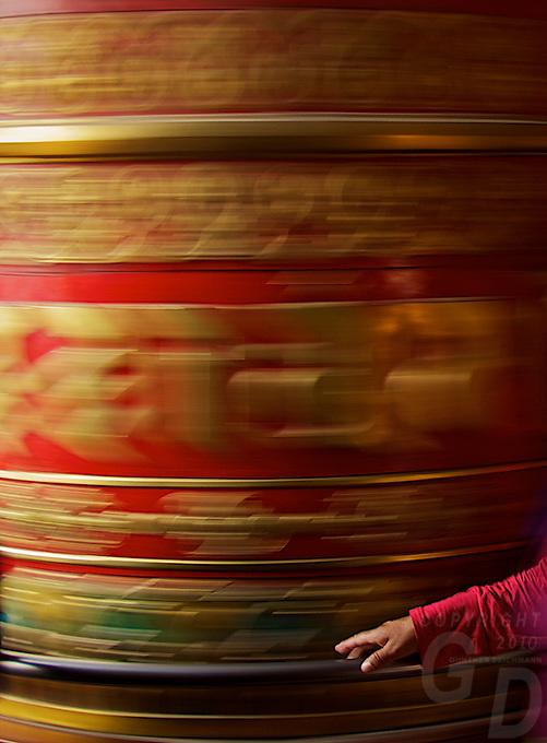 "Prayer Wheel and hand - Full Moon Festival at the Boudhanath Stupa ""Little Tibet"" Kathmandu, Nepal"