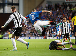 Lee Wallace suffers a two footed lunge which launches him up into the air