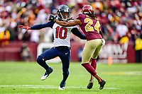 Landover, MD - November 18, 2018: Washington Redskins cornerback Josh Norman (24) is called for a crucial holding penalty on Houston Texans wide receiver DeAndre Hopkins (10) late in the fourth quarter of game between the Houston Texans and the Washington Redskins at FedEx Field in Landover, MD. The Texans defeated the Redskins 23-21. (Photo by Phillip Peters/Media Images International)