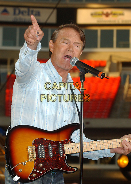 08 August 2017 - Various - Glen Campbell, the voice behind 21 Top 40 hits including &quot;Rhinestone Cowboy,&quot; &quot;Wichita Lineman&quot; and &quot;By the Time I Get to Phoenix,&quot; died Tuesday. He was 81. During a career that spanned six decades, Campbell sold over 45 million records. In 1968, he outsold the Beatles. Campbell was married four times, and has five sons and three daughters. In the early 1980s, while battling alcoholism and cocaine addiction, Campbell made tabloid headlines with a 15-month, high-profile relationship with country singer Tanya Tucker, who was 22 years his junior. In 1981, he became a born-again Christian and in 1982 he married Kimberly Woollen, a Radio City Music Hall Rockette. In 2003, he was arrested for a hit-and-run, an incident that ended with him allegedly kneeing a police officer in the thigh right before he was released. Campbell pleaded guilty to extreme drunken driving and leaving the scene of an accident, and spent 10 days in jail. In 2011, Campbell, then 75, revealed that he was diagnosed with Alzheimer's disease. In June of that year, he announced he was retiring from music due to the disease. He released his final album of original music Ghost and embarked on a farewell tour with three of his children backing him. File Photo: June 13, 2004; Nashville, TN, USA; Singer GLEN CAMPBELL during the 2004  CMA Music Festival held at the Coliseum. Glen Campbell, who pleaded guilty last month to extreme drunken driving and leaving the scene of an accident, had his sentence delayed so he could perform Sunday at the CMA Music Festival. <br /> CAP/MPI/FS<br /> &copy;FS/MPI/Capital Pictures