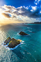 The view from a helicopter tour of the Mokulua Islands as the sun rises over Windward O'ahu.