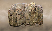 Photo of Hittite monumental relief sculpted orthostat stone panel of a Procession. Limestone, Karkamıs, (Kargamıs), Carchemish (Karkemish), 900 - 700 B.C. Anatolian Civilisations Museum, Ankara, Turkey.<br /> <br /> It is a depiction of three marching female figures in long dress with a high headdress (photos) at their head. These women are considered to be the nuns of the Goddess Kubaba. The figure in the front has a small animal in her right hand while the figure in the middle has a glass in his right hand. The object which the figures carry in their left is not understood.  <br /> <br /> Against a brown art background.