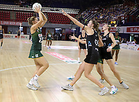 JOHANNESBURG, SOUTH AFRICA - JANUARY 25:  Maryka Holtzhausen of the SPAR Proteas shoots for goal with Kelly Jury of the Silver Ferns defending during the Netball Quad Series netball match between Spar Proteas and Silver Ferns at the Ellis Park Arena in Johannesburg. Mandatory Photo Credit: ©Reg Caldecott/Michael Bradley Photography