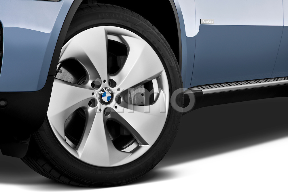 Tire and wheel close up detail view of a 2010 BMW Active Hybrid X6
