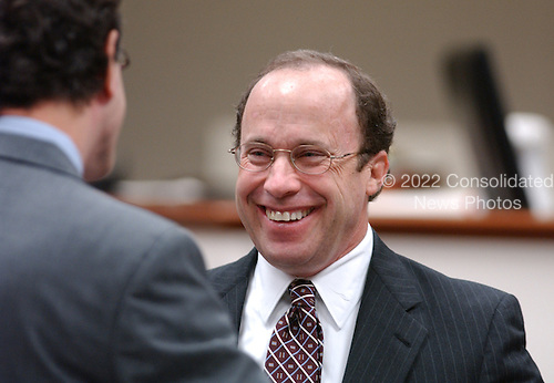 Defense attorney Peter Greenspun, right, talks with Jonathan Shapiro, left, prior to the start of the trial of sniper suspect John Allen Muhammad at the Virginia Beach Circuit Court in Virginia Beach, Virginia on November 13, 2003. <br /> Credit: Steve Earley - Pool via CNP