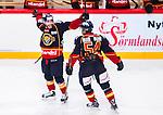 Stockholm 2014-09-17 Ishockey SHL Djurg&aring;rdens IF - Leksands IF :  <br /> Djurg&aring;rdens Mattias Guter har gjort 3-0 och jublar med Robin Alvarez och Alexander Deilert <br /> (Foto: Kenta J&ouml;nsson) Nyckelord:  Djurg&aring;rden DIF Hockey Globen Ericsson Globe Arena SHL Leksand LIF jubel gl&auml;dje lycka glad happy