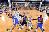 12 November 2010:  FIU's Jeremy Allen (32) blocks a shot by Florida Memorial's George Gray (11) with Florida Memorial's Son Nickey Beauge (32) and FIU's DeJuan Wright (14) looking on in the first half as the FIU Golden Panthers defeated the Florida Memorial Lions, 89-73, at the U.S. Century Bank Arena in Miami, Florida.
