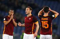 Calcio, Serie A: Roma vs Fiorentina. Roma, stadio Olimpico, 4 marzo 2016.<br /> Roma&rsquo;s Francesco Totti, center, reacts with teammates William Vainqueur, left, and Miralem Pjanic, after missing to score on a free kick during the Italian Serie A football match between Roma and Fiorentina at Rome's Olympic stadium, 4 March 2016.<br /> UPDATE IMAGES PRESS/Riccardo De Luca