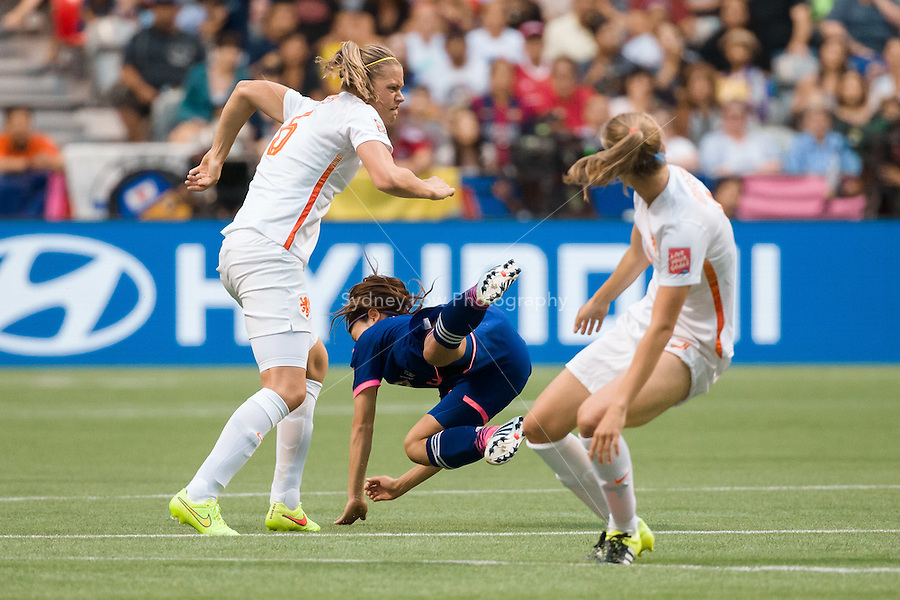 June 23, 2015: Aya SAMESHIMA of Japan flys through the air during a round of 16 match between Japan and Netherlands at the FIFA Women's World Cup Canada 2015 at BC Place Stadium on 23 June 2015 in Vancouver, Canada. Japan won 2-1. Sydney Low/AsteriskImages.com